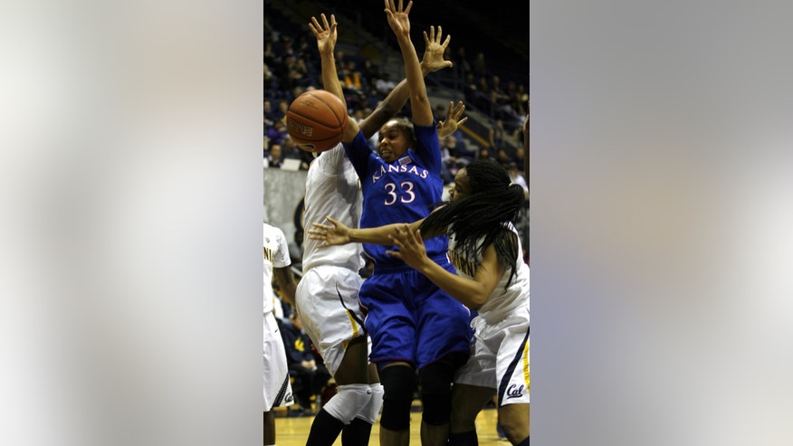 Kansas' Tania Jackson (33) fights for a rebound with California's Brittany Boyd, right, and an unidentified player in the first half of an NCAA women's college basketball game in Berkeley, Calif., Friday, Dec. 21, 2012. (AP Photo/Dino Vournas)