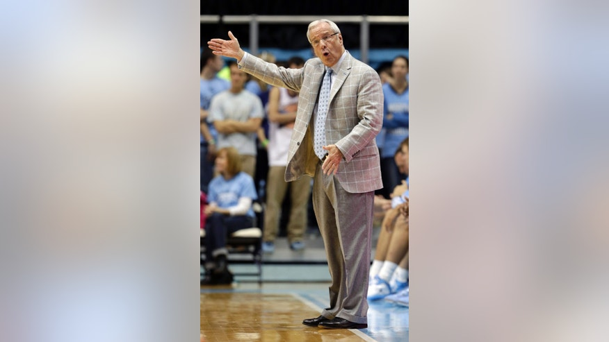 North Carolina coach Roy Williams directs his team against McNeese State during the first half of an NCAA college basketball game in Chapel Hill, N.C., Saturday, Dec. 22, 2012. North Carolina won 97-63. (AP Photo/Gerry Broome)