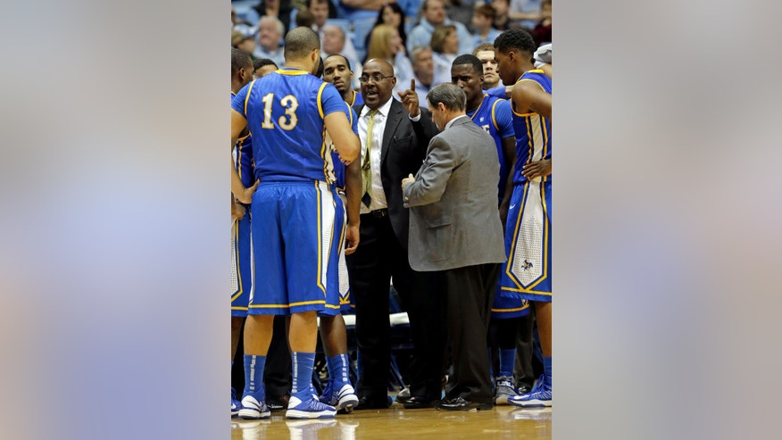 McNeese State coach Dave Simmons speaks with his team during a timeout in the second half of an NCAA college basketball game against North Carolina in Chapel Hill, N.C., Saturday, Dec. 22, 2012. North Carolina won 97-63. (AP Photo/Gerry Broome)