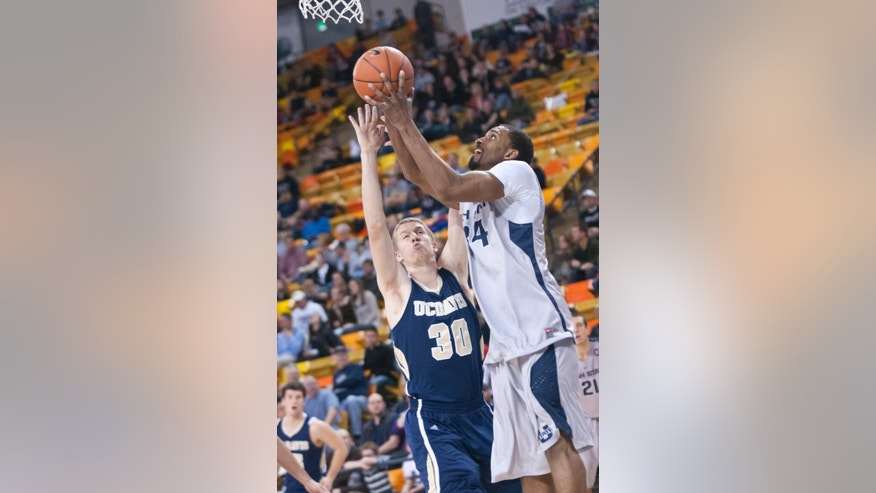 Utah State's Kyisean Reed shoots the ball around UC Davis' Tyler Ott during the 2nd half of the World Vision Basketball Challenge at Dee Glen Smith Spectrum stadium Friday Dec. 21, 2012. (AP Photo/The Herald Journal, Jennifer Meyers)
