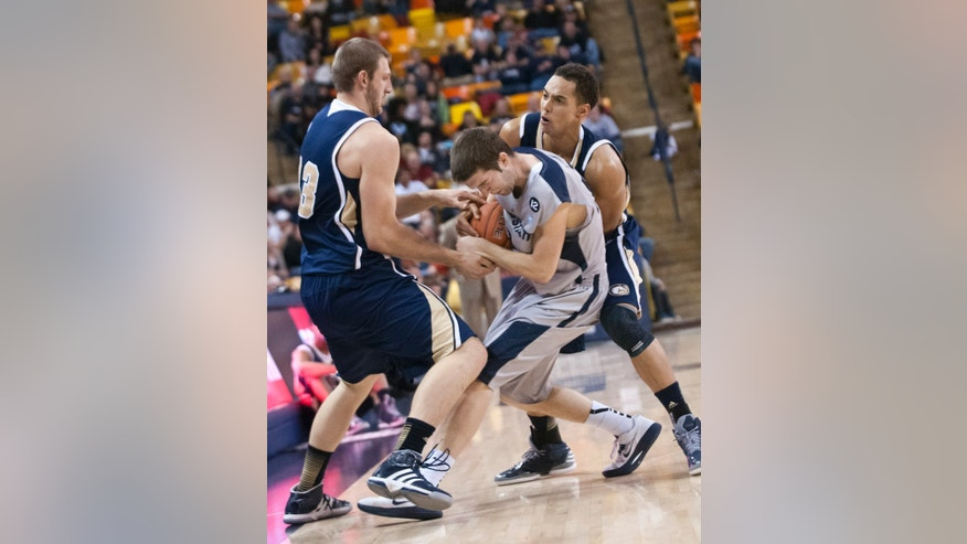 Utah State's Preston Medlin fights for the ball from UC Davis' Clint Bozner (left) and Ryan Sypkens during the 2nd half of the World Vision Basketball Challenge at Dee Glen Smith Spectrum stadium Friday Dec. 21, 2012. (AP Photo/The Herald Journal, Jennifer Meyers)