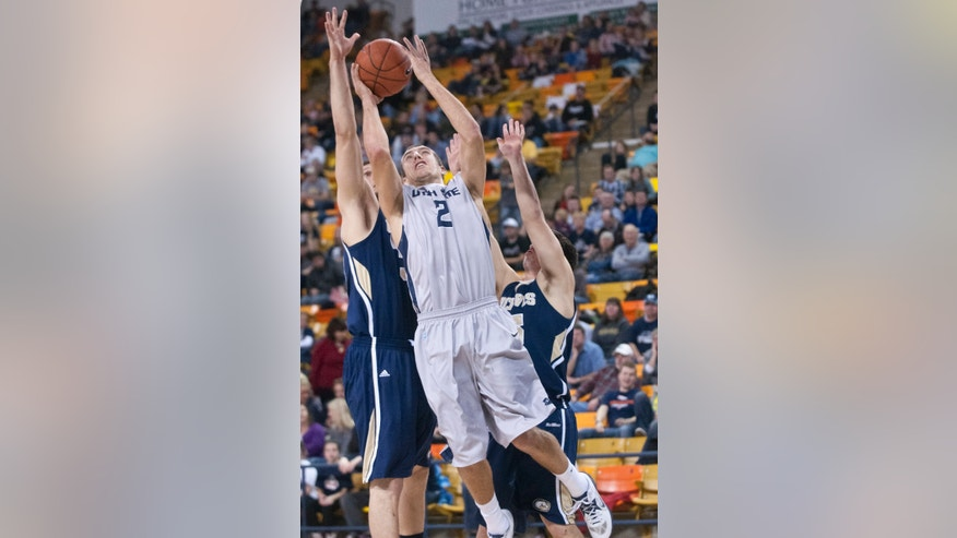 Utah State's Spencer Butterfield shoots through UC Davis defense during the World Vision Basketball Challenge at Dee Glen Smith Spectrum stadium in Logan, Utah on Friday Dec. 21, 2012. (AP Photo/The Herald Journal, Jennifer Meyers)