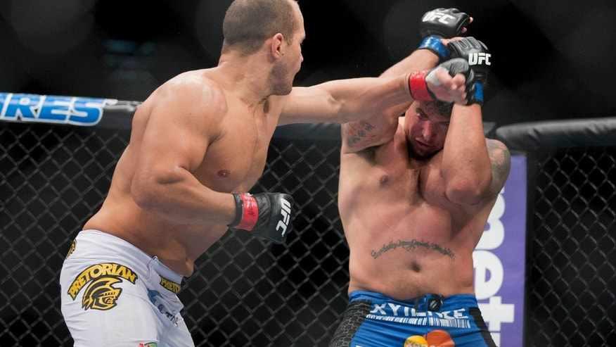 Junior Dos Santos, here throwing punches against Frank Mir, will fight Cain Velasquez on Dec. 29.