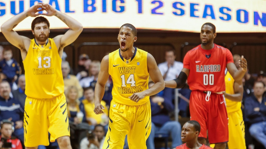 West Virginia's Gary Browne (14) reacts after a Radford turnover during the second half of an NCAA college basketball game at WVU Coliseum in Morgantown, W.Va., Saturday, Dec. 22, 2012. West Virginia defeated Radford 72-62. (AP Photo/David Smith)