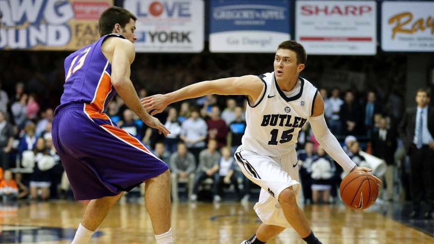 Butler guard Rotnei Clarke, right, goes around Evansville guard Jordan Jahr during the first half of an NCAA college basketball game Saturday, Dec. 22, 2012 in Indianapolis. (AP Photo/AJ Mast)