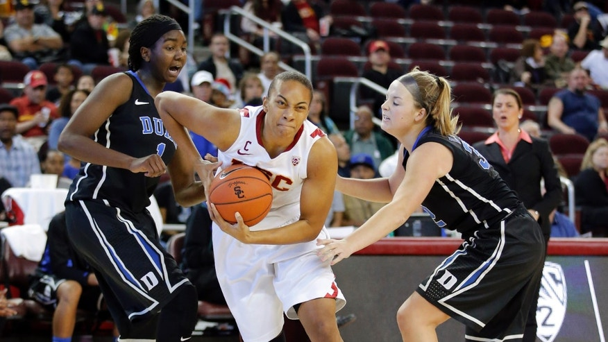 Southern California's Alexyz Vaioletama, center, drives past Duke's Elizabeth Williams, left, and Duke's Tricia Liston during the first half of an NCAA college basketball game in Los Angeles, Saturday, Dec. 22, 2012. (AP Photo/Jae C. Hong)