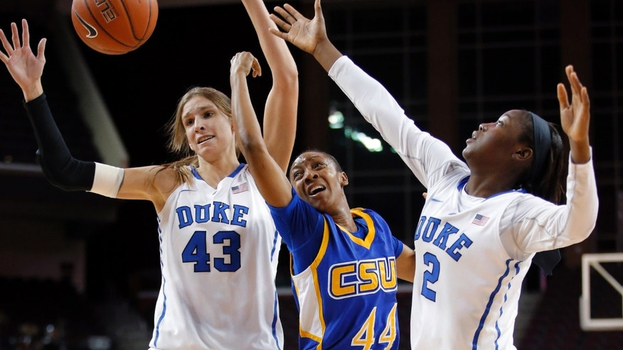 Cal State Bakersfield guard Tyonna Outland, center, is double-teamed by Duke's Allison Vernerey, left, and Alexis Jones during the first half of an NCAA college basketball game in Los Angeles, Friday, Dec. 21, 2012. (AP Photo/Jae C. Hong)