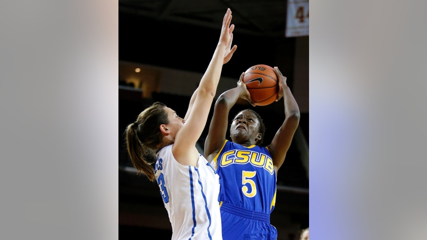 Cal State Bakersfield forward Batabe Zempare, right, looks to shoot against Duke's Haley Peters during the first half of an NCAA college basketball game in Los Angeles, Friday, Dec. 21, 2012. (AP Photo/Jae C. Hong)