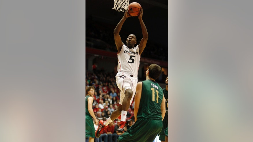 Cincinnati forward Justin Jackson (5) goes up for a basket against Wright State forward J.T. Yoho (11) during the first half of an NCAA college basketball game, Saturday, Dec. 22, 2012, in Cincinnati. (AP Photo/David Kohl)