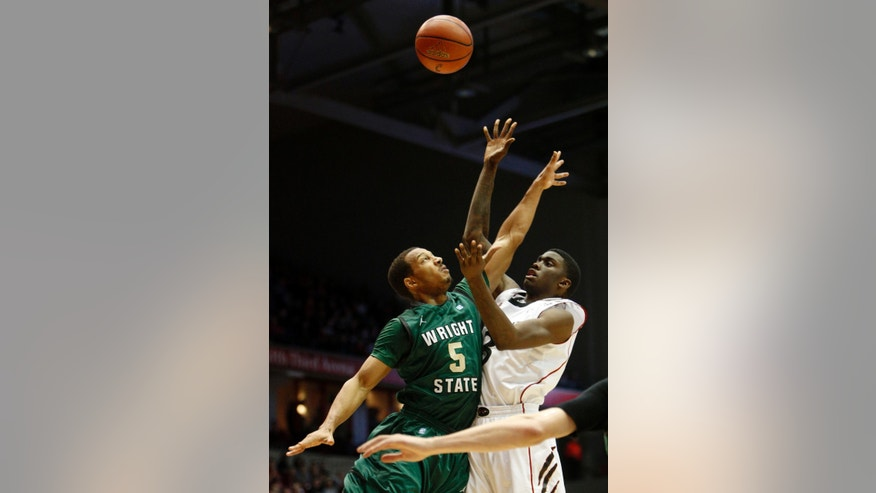Cincinnati forward Shaquille Thomas (3) shoots against Wright State guard Miles Dixon (5) during the first half of an NCAA college basketball game, Saturday, Dec. 22, 2012, in Cincinnati. (AP Photo/David Kohl)
