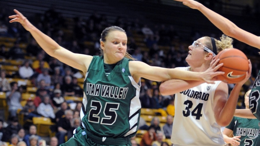 Kaycee Mansfield (25) of Utah Valley, tries to stop Jen Reese, of Colorado, from shooting during the first half of  an NCAA college basketball game  Saturday Dec. 22, 2012  in Boulder, Colo. (AP Photo/Daily Camera, Cliff Grassmick)