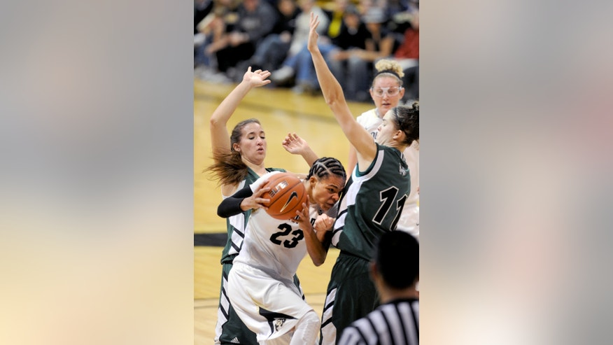 Chucky Jeffery, of Colorado,  drives into Sammie Jensen and past Tina Doughty, both of Utah Valley during the second  half of  an NCAA college basketball game  Saturday Dec. 22, 2012  in Boulder, Colo. (AP Photo/Daily Camera, Cliff Grassmick)
