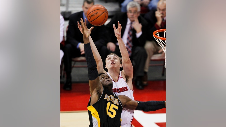 Wisconsin's Sam Dekker, rear, an Milwaukee's Demetrius Harris reach for the ball during the first half of an NCAA college basketball game Saturday, Dec. 22, 2012, in Madison, Wis. (AP Photo/Andy Manis)