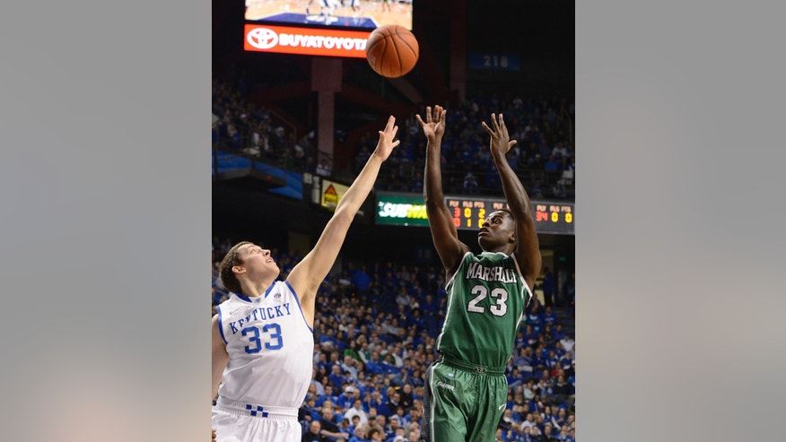 Marshall's D.D. Scarver, right, gets a shot off over the defense of Kentucky's Kyle Wiltjer during the first half of an NCAA college basketball game Saturday, Dec. 22, 2012, in Lexington, Ky. (AP Photo/Timothy D. Easley)