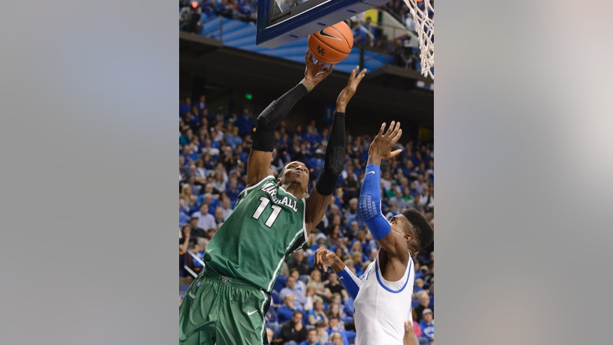 Marshall's Nigel Spikes, left, sets a shot off over Kentucky's Nerlins Noel during the first half of an NCAA college basketball game Saturday, Dec. 22, 2012, in Lexington, Ky. (AP Photo/Timothy D. Easley)