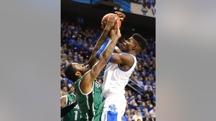 Marshall's Robert Goff, left, attempts to block the shot of Kentucky's Nerlens Noel during the second half of an NCAA college basketball game Saturday, Dec. 22, 2012, in Lexington, Ky. Kentucky defeated Marshall 82-54. (AP Photo/Timothy D. Easley)