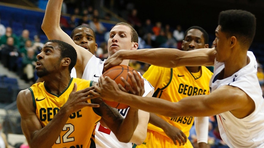 George Mason's Vaughn Gray, left,  has the ball stripped by Richmond's Deion Taylor, right,  as Richmond's Greg Robbins, center,  defends during first half action of an NCAA college basketball game in the 2012 Governor's Holiday Hoops Classic at The Richmond Coliseum in  Richmond, VA.,Saturday, Dec., 22,2012. (AP Photo/The Richmond Times-Dispatch, Joe Mahoney)