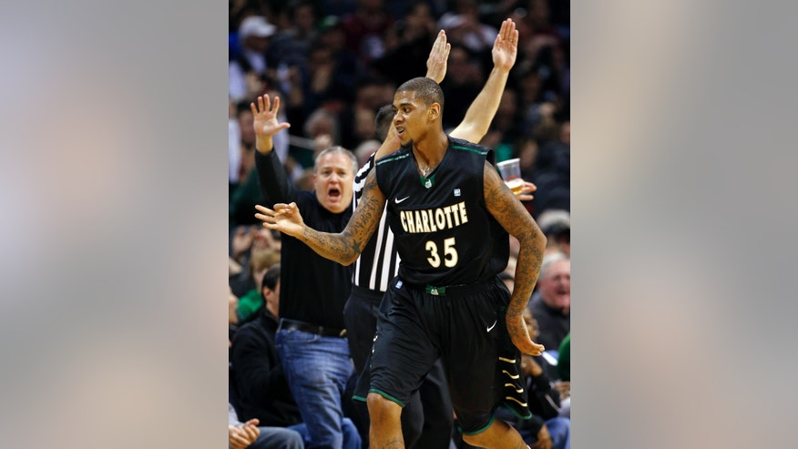 Charlotte's Chris Braswell (35) reacts after making a three-point basket against Florida State during the first half of an NCAA college basketball game, Saturday, Dec. 22, 2012, in Charlotte, N.C. (AP Photo/Chuck Burton)