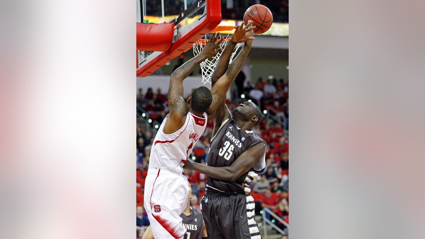 St. Bonaventure's Youssou Ndoye (35) blocks the shot of North Carolina State's Richard Howell (1) during the first half of an NCAA college basketball game in Raleigh, N.C., Saturday, Dec. 22, 2012. (AP Photo/Karl B DeBlaker)