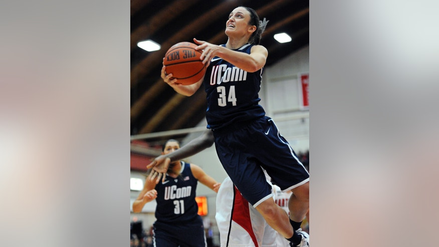 Connecticut's Kelly Faris (34) goes up for a basket during the first half of an NCAA women's college basketball game against Hartford, Saturday, Dec. 22, 2012, in West Hartford, Conn. (AP Photo/Jessica Hill)
