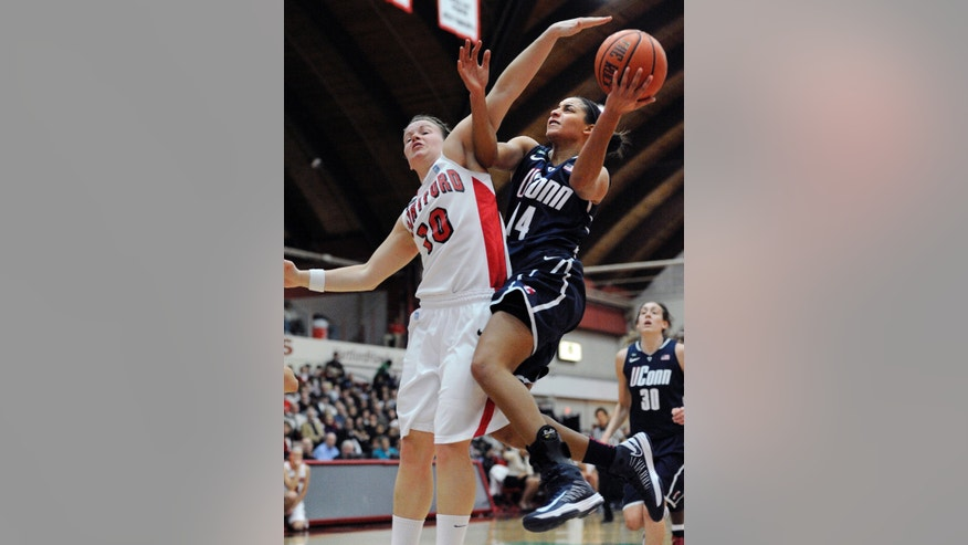 Connecticut's Bria Hartley, right is fouled by Hartford's Alex Hall, left, during the first half of an NCAA women's college basketball game at the Hartford, Saturday, Dec. 22, 2012, in West Hartford, Conn. (AP Photo/Jessica Hill)