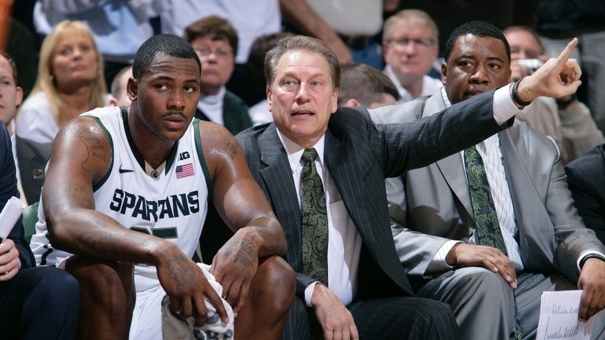 Michigan State coach Tom Izzo, center, sits next to Derrick Nix, left, on the bench during the second half of an NCAA college basketball game against Texas, Saturday, Dec. 22, 2012, in East Lansing, Mich. At right is associate head coach Dwayne Stephens. Michigan State won 67-56. (AP Photo/Al Goldis)