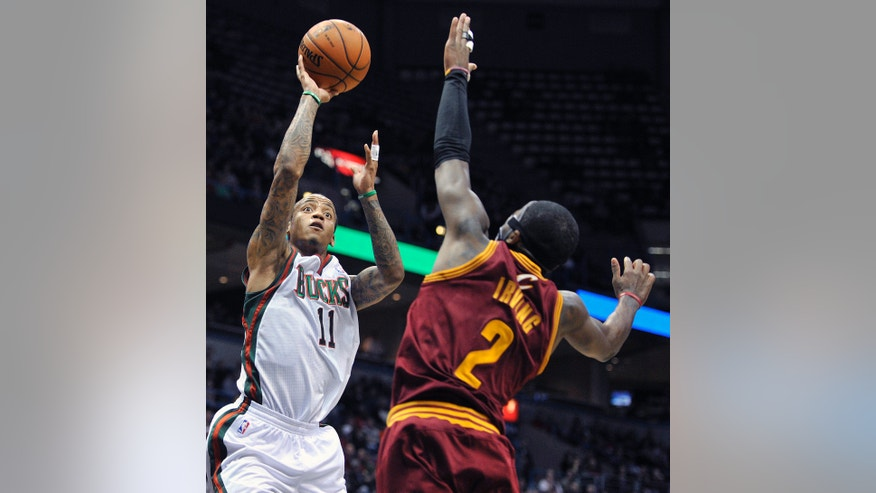 Milwaukee Bucks' Monta Ellis (11) shoots over Cleveland Cavaliers' Kyrie Irving (2) during the second half of an NBA basketball game Saturday, Dec. 22, 2012, in Milwaukee. The Cavaliers defeated the Bucks 94-82. (AP Photo/Jim Prisching)