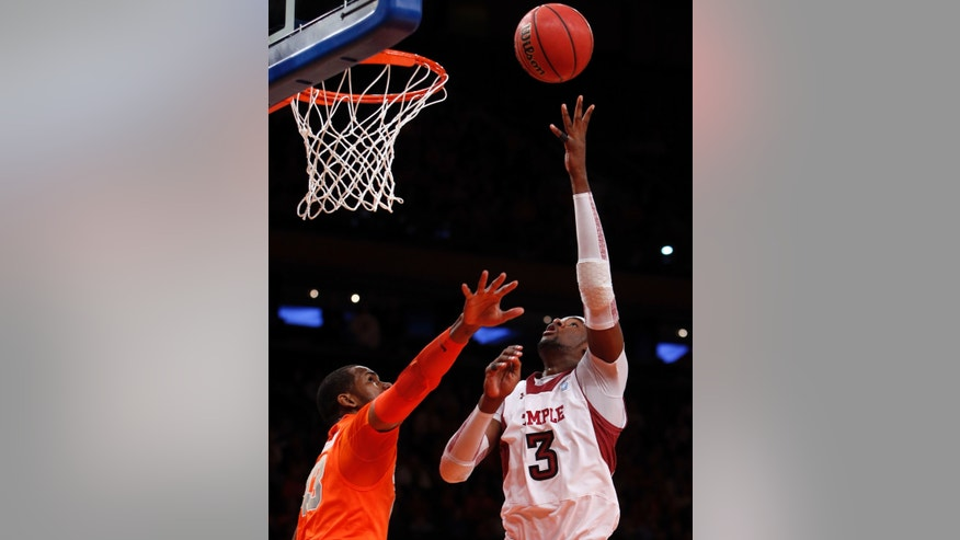 Temple's Anthony Lee (3) shoots over Syracuse's James Southerland during the first half of an NCAA college basketball game in the Gotham Classic at Madison Square Garden, Saturday, Dec. 22, 2012, in New York. (AP Photo/Jason Decrow)