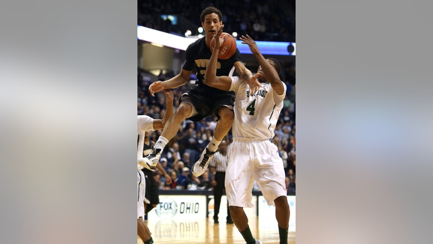 Wofford forward Lee Skinner, left, battles Xavier forward Travis Taylor for a rebound in the second  half of an NCAA  college basketball game on Saturday, Dec. 22, 2012, in Cincinnati. Wofford won 56-55. (AP Photo/Tony Tribble)