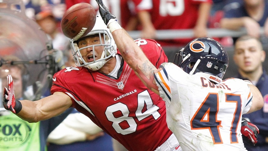 Arizona Cardinals tight end Rob Housler (84) tries to pull in a pass as Chicago Bears free safety Chris Conte (47) defends during the first half of an NFL football game, Sunday, Dec. 23, 2012, in Glendale, Ariz. (AP Photo/Paul Connors)
