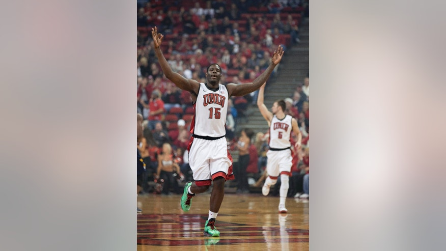 UNLV forward Anthony Bennett (15) gestures after a 3-point shot during the first half of an NCAA college basketball game against Canisius, Saturday, Dec. 22, 2012, in Las Vegas. (AP Photo/Eric Jamison)