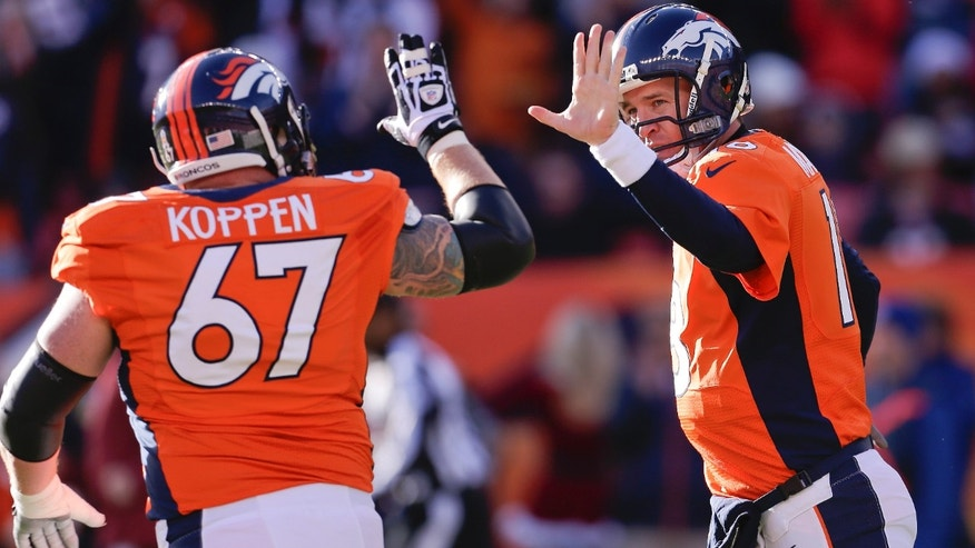 Denver Broncos quarterback Peyton Manning (18) gets a high five from Denver Broncos center Dan Koppen (67) after Manning threw a touchdown pass against the Cleveland Browns in the first quarter of an NFL football game, Sunday, Dec. 23, 2012, in Denver. (AP Photo/Joe Mahoney)
