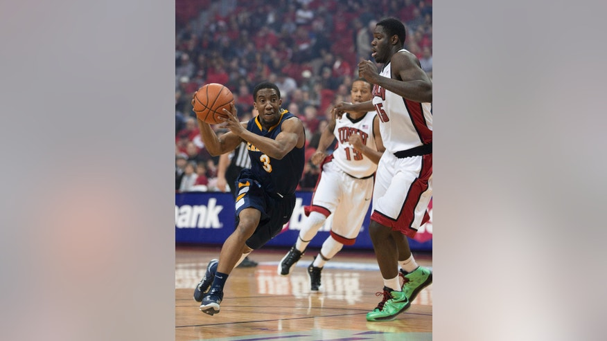 Canisius guard Harold Washington (3) drives past UNLV forward Anthony Bennett (15) during the first half of an NCAA college basketball game Saturday, Dec. 22, 2012, in Las Vegas. (AP Photo/Eric Jamison)