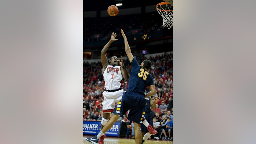 UNLV forward Quintrell Thomas (1) takes a shot while being defended by Canisius forward Jordan Heath (35) during the second half of an NCAA college basketball game Saturday, Dec. 22, 2012 in Las Vegas. UNLV defeated Canisius 89-74. (AP Photo/Eric Jamison)