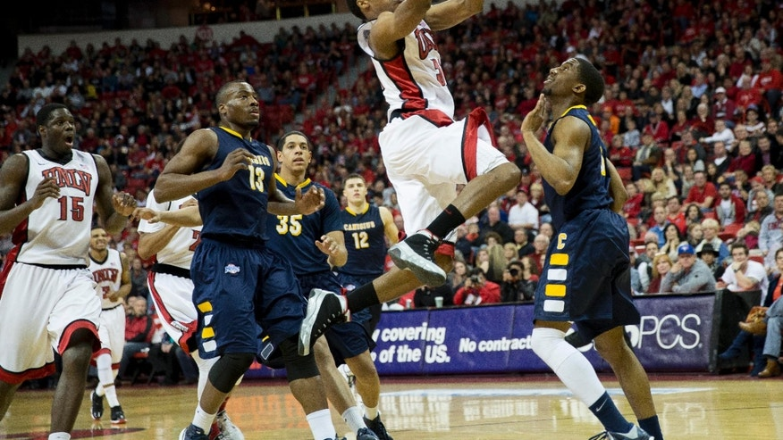 UNLV guard Justin Hawkins (31) takes a shot during the second half of an NCAA college basketball game against Canisius, Saturday, Dec. 22, 2012 in Las Vegas. UNLV defeated Canisius 89-74. (AP Photo/Eric Jamison)