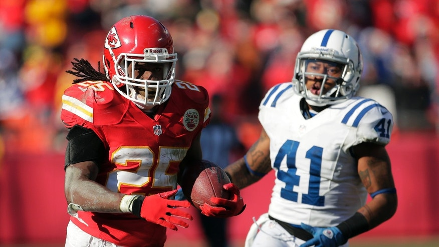 Kansas City Chiefs running back Jamaal Charles, left, runs from Indianapolis Colts free safety Antoine Bethea during the second half of an NFL football game Sunday, Dec. 23, 2012, in Kansas City, Mo. (AP Photo/Charlie Riedel)