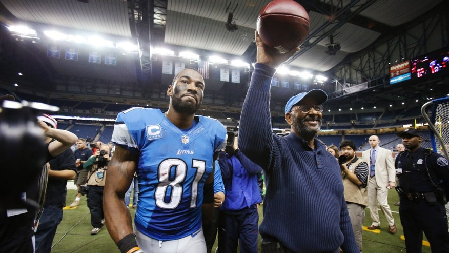 Detroit Lions wide receiver Calvin Johnson and his father, Calvin Sr., walk off the field after the Lions' NFL football game against the Atlanta Falcons at Ford Field in Detroit, Saturday, Dec. 22, 2012. Johnson broke Jerry Rice's single-season record for receiving yards. (AP Photo/Duane Burleson)