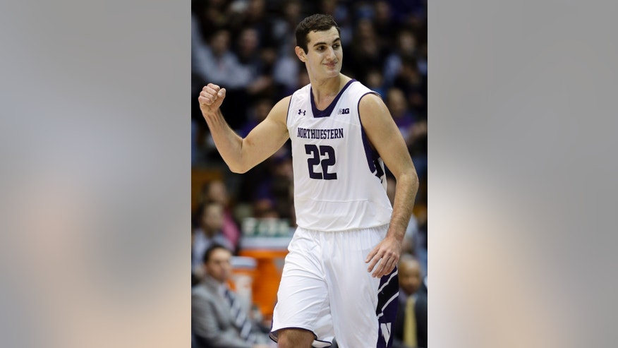 Northwestern center Alex Olah, of Romania, celebrates after scoring a three-point basket during the first half of an NCAA college basketball game against Brown in Evanston, Ill., Sunday, Dec. 23, 2012. (AP Photo/Nam Y. Huh)