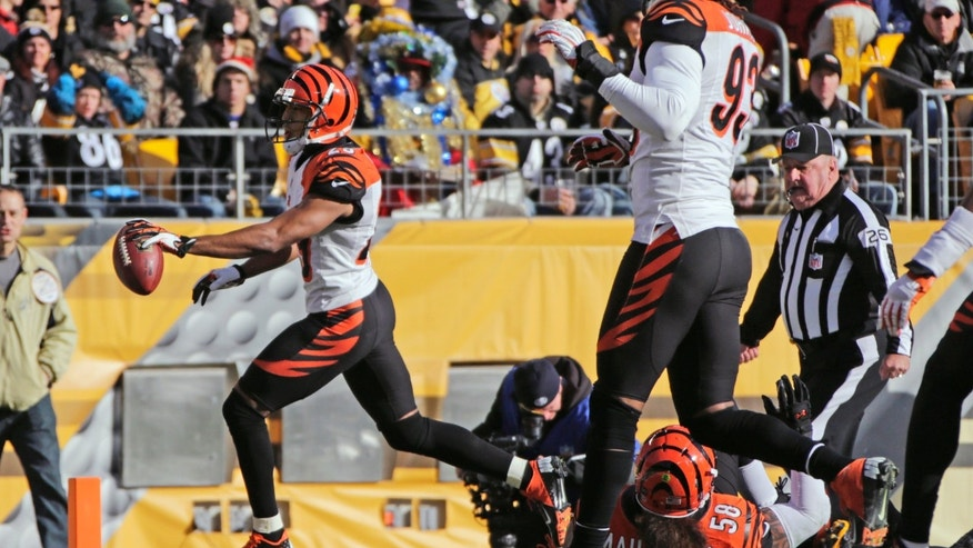 Cincinnati Bengals cornerback Leon Hall, left, trots into the end zone after intercepting a pass from Pittsburgh Steelers quarterback Ben Roethlisberger in the first quarter of an NFL football game in Pittsburgh, Sunday, Dec 23, 2012. (AP Photo/Gene J. Puskar)