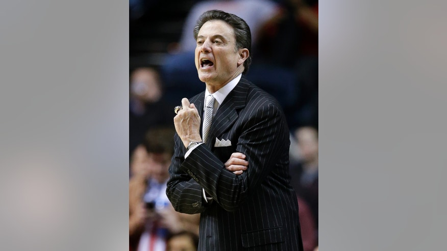 Louisville head coach Rick Pitino yells to his players in the first half of an NCAA college basketball game against Western Kentucky on Saturday, Dec. 22, 2012, in Nashville, Tenn. (AP Photo/Mark Humphrey)