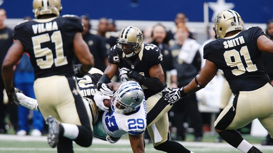 Dallas Cowboys running back DeMarco Murray (29) is taken down by New Orleans Saints cornerback Patrick Robinson (21) and strong safety Roman Harper (41) as Saints' Will Smith (91) and Jonathan Vilma (51) move in during the second half of an NFL football game on Sunday, Dec. 23, 2012, in Arlington, Texas. (AP Photo/Sharon Ellman)