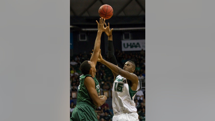 Hawaii center Vander Joaquim (15) holds off Miami forward Kenny Kadji (35) while taking shot in the first half of an NCAA college basketball game in the Diamond Head Classic Saturday, Dec. 22, 2012, in Honolulu. (AP Photo/Eugene Tanner)