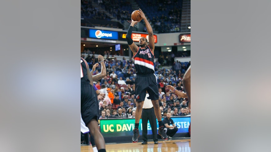 Portland Trail Blazers' LaMarcus Aldridge (12) gets an open shot against the Sacramento Kings during the first half of an NBA basketball game in Sacramento, Calif., on Sunday, Dec. 23, 2012. (AP Photo/Steve Yeater)