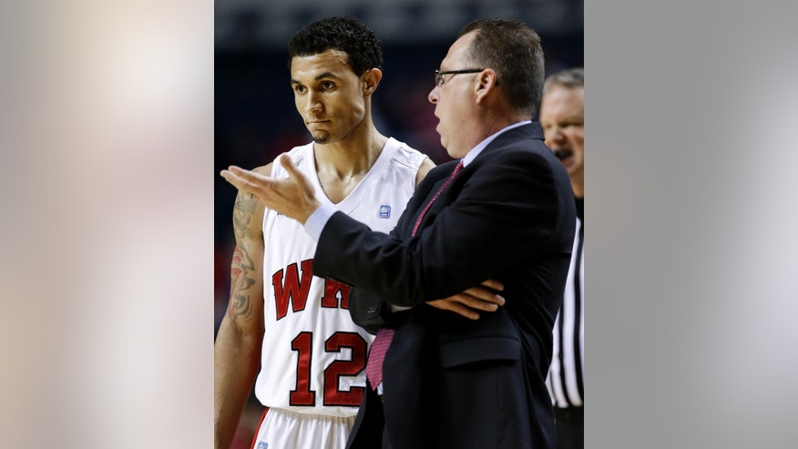 Western Kentucky head coach Ray Harper talks with guard Brandon Harris (12) in the first half of an NCAA college basketball game against Louisville on Saturday, Dec. 22, 2012, in Nashville, Tenn. (AP Photo/Mark Humphrey)