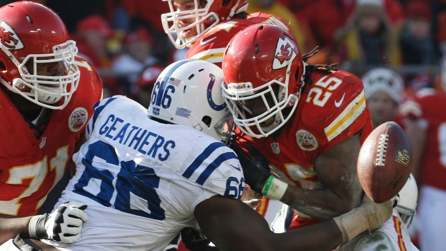 Kansas City Chiefs running back Jamaal Charles (25) fumbles the ball as he is hit by Indianapolis Colts defensive end Clifton Geathers during the first half of an NFL football game Sunday, Dec. 23, 2012, in Kansas City, Mo. The Colts recovered the fumble. (AP Photo/Orlin Wagner)