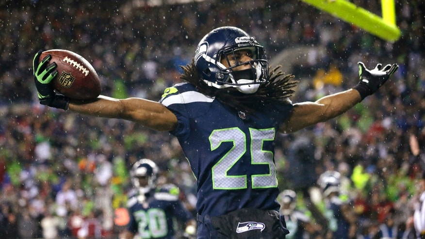 Seattle Seahawks' Richard Sherman motions to fans after intercepting in the end zone against the San Francisco 49ers in the second half of an NFL football game, Sunday, Dec. 23, 2012, in Seattle. The Seahawks won 42-13. (AP Photo/Elaine Thompson)