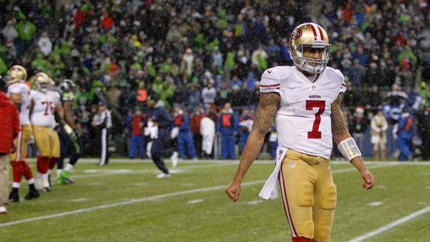 San Francisco 49ers quarterback Colin Kaepernick walks to the sidelines in the final minutes of the the second half against the Seattle Seahawks of an NFL football game, Sunday, Dec. 23, 2012, in Seattle. The Seahawks won 42-13. (AP Photo/John Froschauer)