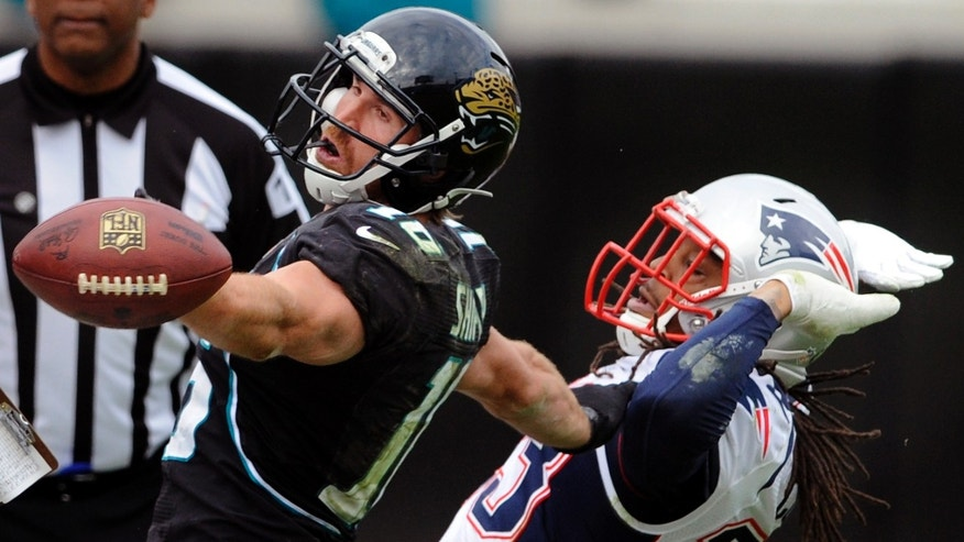 Jacksonville Jaguars wide receiver Jordan Shipley (16) misses a pass while defended by New England Patriots defensive back Marquice Cole (23) during the second half of an NFL football game on Sunday, Dec. 23, 2012, in Jacksonville, Fla. The Patriots defeated the Jaguars 23-16. (AP Photo/Stephen Morton)