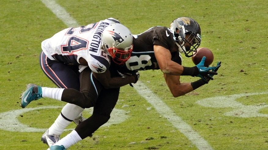 Jacksonville Jaguars wide receiver Cecil Shorts (84) drops a pass while defended by New England Patriots cornerback Kyle Arrington (24) during the second half of an NFL football game on Sunday, Dec. 23, 2012, in Jacksonville, Fla. The Patriots defeated the Jaguars 23-16. (AP Photo/Stephen Morton)