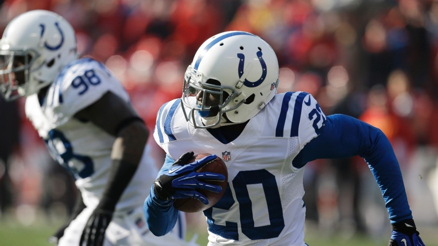 Indianapolis Colts cornerback Darius Butler, right, returns an interception 32 yards for a touchdown during the first half of an NFL football game against the Kansas City Chiefs, Sunday, Dec. 23, 2012, in Kansas City, Mo. (AP Photo/Orlin Wagner)
